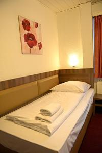 A bed or beds in a room at ITM Hotel Motel21 Hamburg-Mitte