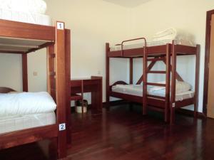 A bunk bed or bunk beds in a room at HI Vila Nova de Foz Coa - Pousada de Juventude