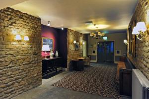 The lobby or reception area at Royal George Hotel by Greene King Inns
