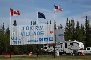 The logo or sign for the campground
