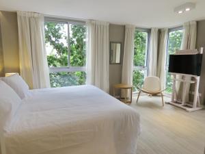 Cama ou camas em um quarto em Smart Hotel Montevideo