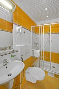 Koupelna v ubytování Hotel Saint Antonius