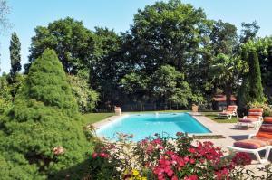 The swimming pool at or near Gîtes La Ferme de Monseignon