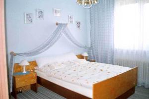 Postel nebo postele na pokoji v ubytování Pension Harmony