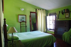 A bed or beds in a room at Posada La Casa Grande