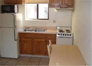 A kitchen or kitchenette at Miles Motel