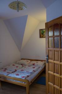 Łóżko lub łóżka w pokoju w obiekcie Willa Jafer - Zakopane Centrum
