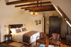 Cama ou camas em um quarto em Hotel Boutique Castillo Rojo