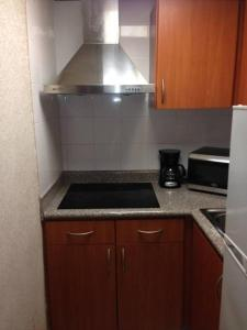 """A kitchen or kitchenette at Modern apartment in San Juan """"Convention Center District Live"""" Best location"""