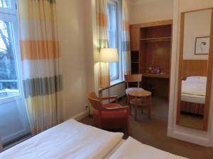 Ein Bett oder Betten in einem Zimmer der Unterkunft Park Hotel Am Lindenplatz