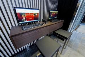 A television and/or entertainment center at Hotel 81 Premier Star (SG Clean)