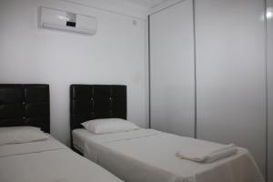 A bed or beds in a room at Rose Residence