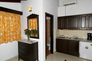 Η κουζίνα ή μικρή κουζίνα στο Afrodite Hotel Apartments