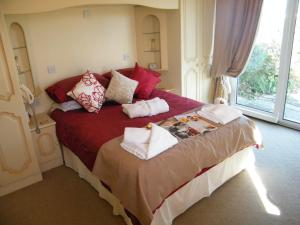 A bed or beds in a room at Eastcote Luxury Guest House