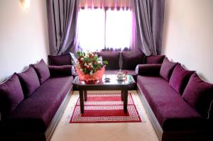 A seating area at Residence Hotel Assounfou