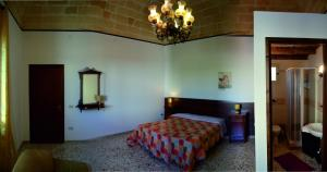 A bed or beds in a room at B&B Dante Alighieri