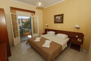 Un ou plusieurs lits dans un hébergement de l'établissement Perros Hotel