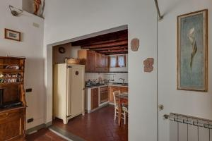 A kitchen or kitchenette at Uffizi Home and Florence