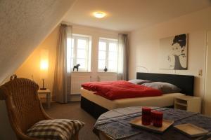 Ein Bett oder Betten in einem Zimmer der Unterkunft Ferienhaus Addebüll