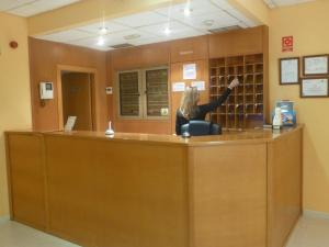 The lobby or reception area at Hostal El Val