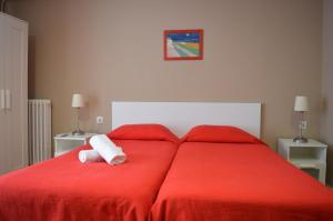 A bed or beds in a room at Somnio Hostels