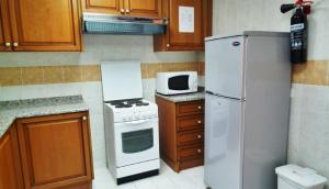 A kitchen or kitchenette at Al Massa Hotel Apartments 1