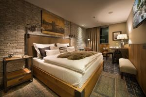 A bed or beds in a room at LOFT Hotel Bratislava