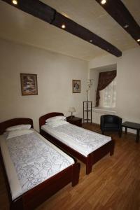 Кровать или кровати в номере Гостевой дом Прайд