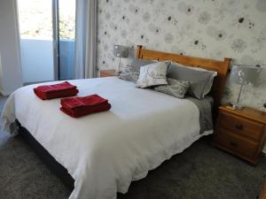 A bed or beds in a room at The Olive Grove Suite