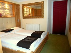 Ein Bett oder Betten in einem Zimmer der Unterkunft Triglerschlössl Appartements