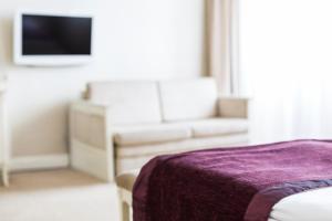 Łóżko lub łóżka w pokoju w obiekcie Hotel Herman