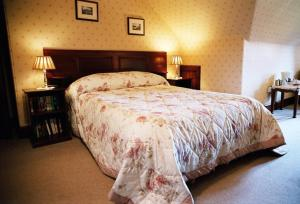 A bed or beds in a room at Tigh na Sgiath Country House Hotel