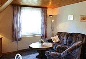 Ein Sitzbereich in der Unterkunft Pension Fröhlich