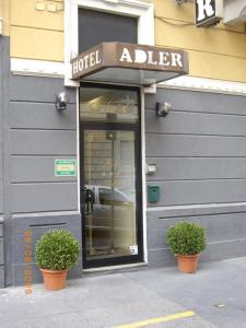 The facade or entrance of Hotel Adler