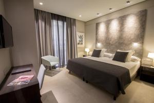 Кровать или кровати в номере Vincci Mercat