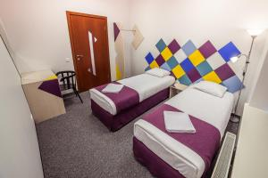 A bed or beds in a room at Mosaic Hotel