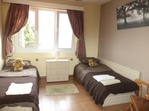 A bed or beds in a room at Elbarr Guest House