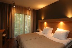 Voodi või voodid majutusasutuse Dirhami Külalistemaja toas