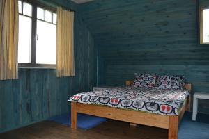Voodi või voodid majutusasutuse Kivi-Roosi Holiday House toas