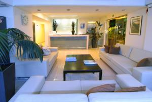 The lobby or reception area at Michel Apartments