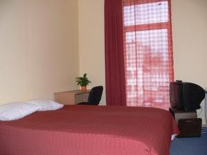 A bed or beds in a room at Hotel Kandava