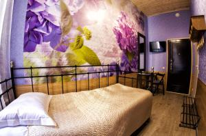 A bed or beds in a room at Bonjour Hotel
