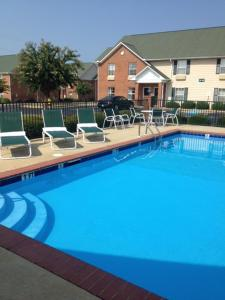 The swimming pool at or near InTown Suites Extended Stay Prattville