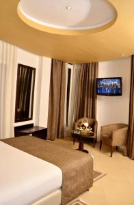 Μια τηλεόραση ή/και κέντρο ψυχαγωγίας στο Malak Hotel