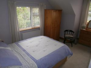 A bed or beds in a room at St.Bridgets Bed and Breakfast