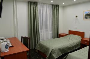 Кровать или кровати в номере Парк Виста