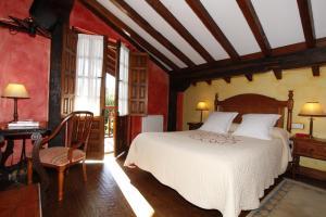 A bed or beds in a room at La Casa del Organista