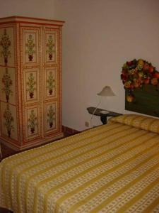 A bed or beds in a room at Torre di Scopello