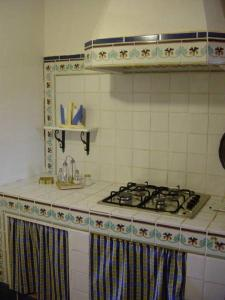 A kitchen or kitchenette at Torre di Scopello