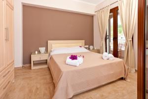 Ένα ή περισσότερα κρεβάτια σε δωμάτιο στο Calm View